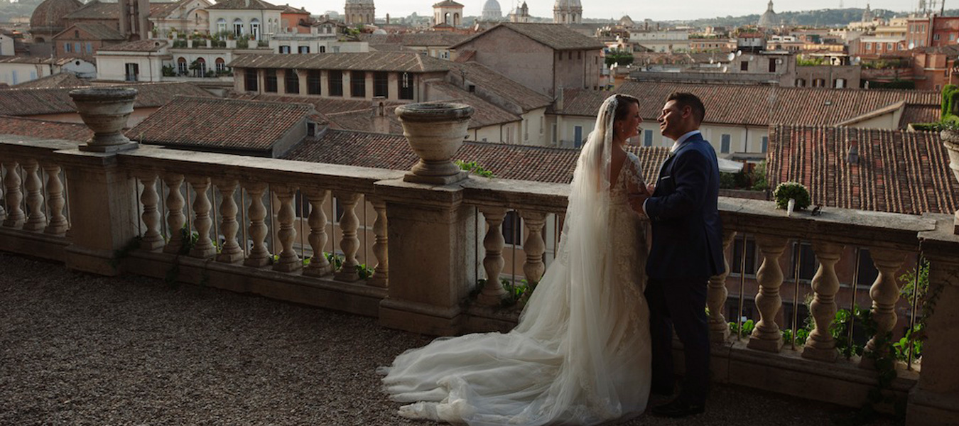A married couple posing for some wedding photographs after getting married in Rome, Italy