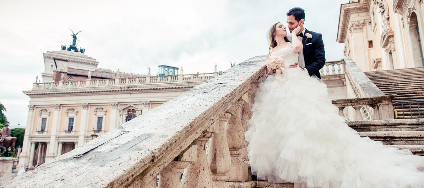 A recently married couple posing for some wedding photos in Rome