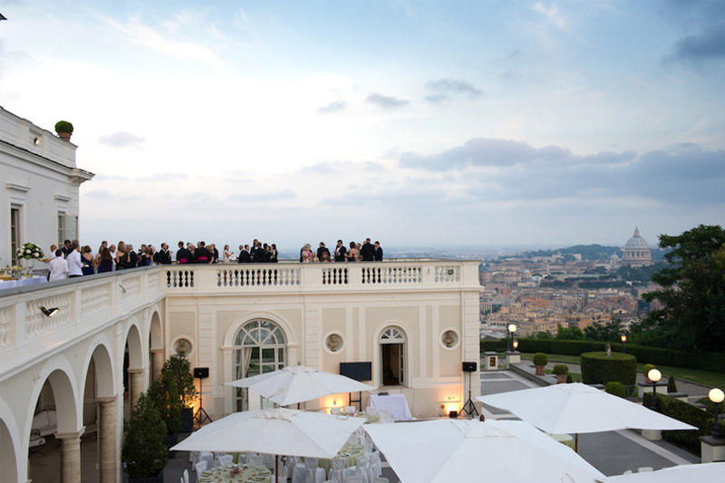 Guests enjoying the amazing view overlooking Rome at wedding reception