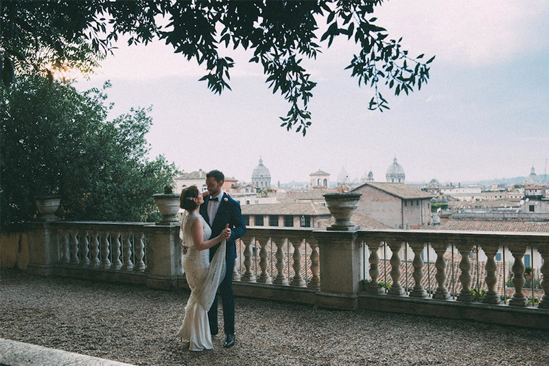 Couple dancing with view of Rome in the background