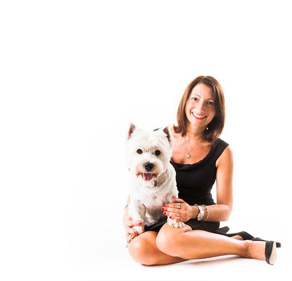 Italian wedding planner and stylist Daniela de Luca, with her dog