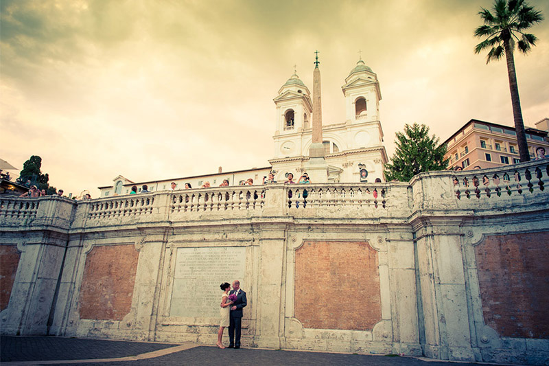 Couple posing in front of Spanish Steps, Rome