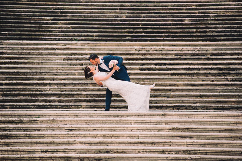 Newlyweds first dance, on the Colosseum steps
